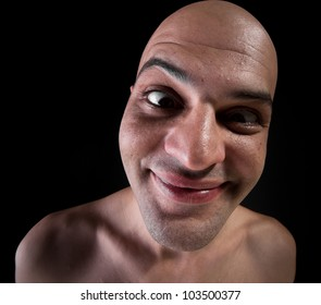 Wide-angle portrait of bald man smiling