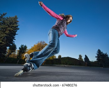 Wide-angle shot of a sliding rollerskater - motion blur on person