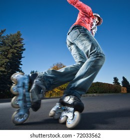Wide-angle shot of a sliding rollerskater - strong motion blur on person