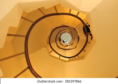 Wide-angle view down a spiral stairs of the lighthouse