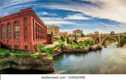 Wide-angle view of Washington Water Power building and the Monroe Street Bridge along the Spokane river, in Spokane, Washington.