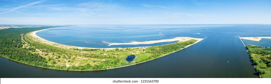 Widefield panoramic aerial view of beach by the blue Baltic sea and Vistula river mouth