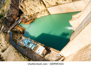"""Wider view of the Dam water exit of the """"El Negratín"""" water reservoir, and its electricity installations, in Baza, Granada province. This is the third biggest water reservoir in Spain."""