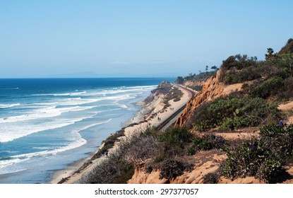 Wideshot of the Del Mar, California coastline, with ocean, cliffs and railroad tracks.