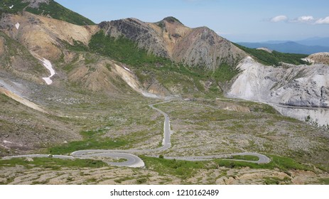 Widing and straight road in a desolate -volcano place
