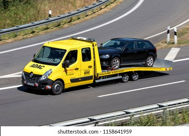 WIEHL, GERMANY - JULY 7, 2018: ADAC flatbed recovery vehicle on motorway. German ADAC it is the largest automobile club in Europe.