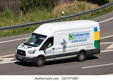 WIEHL, GERMANY - JUNE 24, 2019: Euromaster Ford Transit van on motorway.