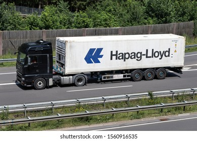 WIEHL, GERMANY - JUNE 24, 2019: MAN TGA truck with Hapag-Lloyd container on motorway.