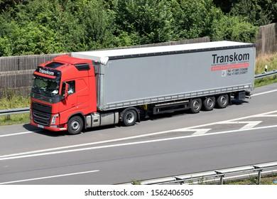 WIEHL, GERMANY - JUNE 24, 2019: Transkom Volvo FH truck with curtainside trailer on motorway.
