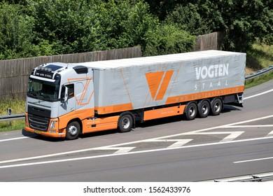 WIEHL, GERMANY - JUNE 24, 2019: Vogten Volvo FH truck with tarpaulin trailer on motorway.