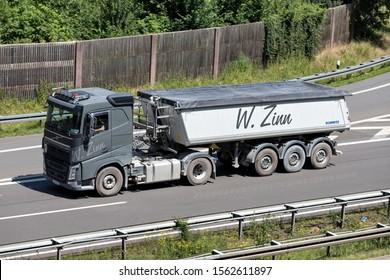 WIEHL, GERMANY - JUNE 24, 2019: W. Zinn Volvo FH truck with tipper trailer on motorway.