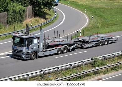 WIEHL, GERMANY - JUNE 25, 2019: BLG Logistics Mercedes-Benz car-carrying truck on motorway.