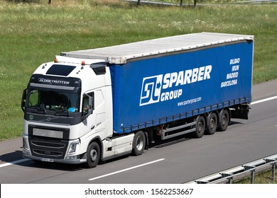 WIEHL, GERMANY - JUNE 25, 2019: Sparber Group Volvo FH truck with curtainside trailer on motorway.