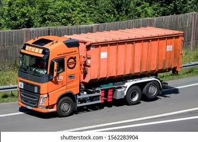 WIEHL, GERMANY - JUNE 25, 2019: Stubs Volvo FH roll-off conatiner truck on motorway.