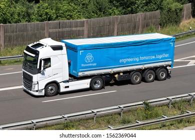 WIEHL, GERMANY - JUNE 25, 2019: ThyssenKrupp Volvo FH truck with tarpaulin trailer on motorway.
