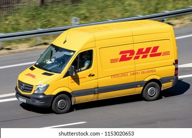 WIEHL, GERMANY - JUNE 29, 2018: DHL delivery van on Motorway. DHL is a division of the German logistics company Deutsche Post AG providing international express mail services.
