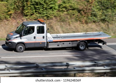 WIEHL, GERMANY - September 29, 2018: assistance partner flatbed recovery vehicle on motorway. assistance partner is the second largest provider of breakdown and accident assistance in Germany.