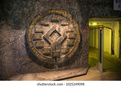 WIELICZKA, POLAND - MAY 28, 2016: Emblem of the UNESCO world heritage sites in the Wieliczka Salt Mine. Opened in the 13th century, the mine produced salt. Is as one of the world's oldest salt mines.