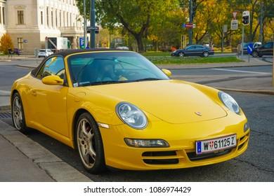 WIEN, AUSTRIA - NOVEMBER 07, 2017: Yellow Porshe on a city street in Wien
