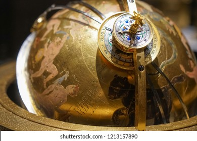 WIEN, AUSTRIA - NOVEMBER 08, 2017: Armillary Sundial Zodiac Spherical Astrology Pedestal. golden astrolabe. constellations in the starry sky