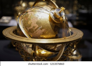 WIEN, AUSTRIA - NOVEMBER 08, 2017: Armillary Sundial Zodiac Spherical Astrology Pedestal. golden astrolabe. constellations in the starry sky