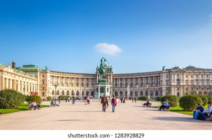 Wien / Austria -  October 10 2014: Tourists walking near the Neue burg,  the new part of the Hofburg palace in historical part pf Vienna