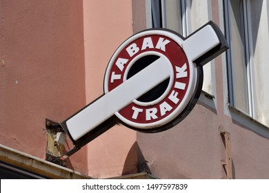 "Wiener Neustadt, Austria - September 5, 2019: Typical Austrian sign for a tobacconist ""Tabak Trafik"" on a house wall in Wiener Neustadt"