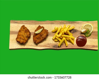 Wiener Schnitzel with french fries on a wooden plate, green background, green screen