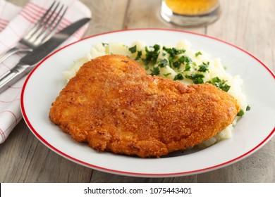 Wiener schnitzel with mashed potato and beer