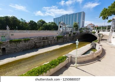 Wienfluss Vienna River flowing under the bridge at Stadtpark, City Park in Vienna, Austria during summer season