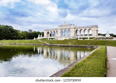 WIENNA, AUSTRIA – SEPTEMBER 31, 2017: View of the Gloriette building with the fountain in front and blue cloudy sky in the background taken at Schonbrunn Palace, WIENNA, AUSTRIA