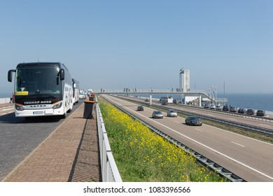 Wieringen, The Netherlands - April 20, 2018: International tourists arriving in buses to visit the monument at the location where the afsluitdijk is closed.