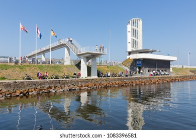 Wieringen, The Netherlands - April 20, 2018: Tourists visiting the monument at the location where the afsluitdijk is closed.