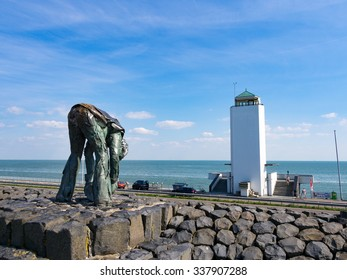 WIERINGEN, NETHERLANDS - AUG 27: Statue of the steenzetter at the Afsluitdijk in Netherlands on August 27, 2013. The Afsluitdijk is a major causeway in the Netherlands.
