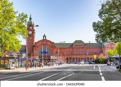Wiesbaden, Germany - April 10, 2011: facade of famous classsicistic old train station in Wiesbaden with people