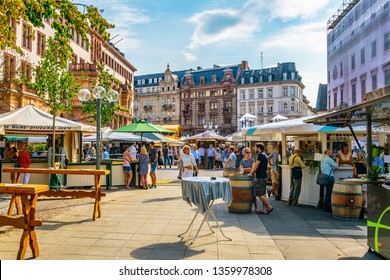 WIESBADEN, GERMANY, AUGUST 17, 2018: Tourists are strolling on marktplatz in the center of Wiesbaden, Germany