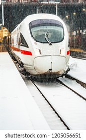 WIESBADEN, GERMANY - DEC 20, 2009: snowfall at the train station in Wiesbaden, Germany with highspeed train in snow.