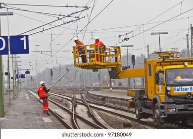 WIESBADEN, GERMANY - FEBRUARY 2: workers repair the catenary on February 2,2011 in Wiesbaden, Germany. The equipment is rented by Boehls, the leading rental company in Europe.