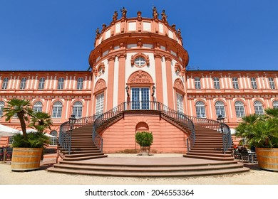 Wiesbaden, Germany - July 2021: Main entrance with stairs of baroque palace called 'Schloss Biebrich', a ducal residence built in 1702 in Wiesbaden in Germany
