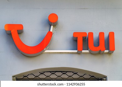 Wiesbaden, Germany - June 03 2018: TUI logo on a facade. TUI Group is the largest travel and tourism company in the world, headquartered in Hannover.