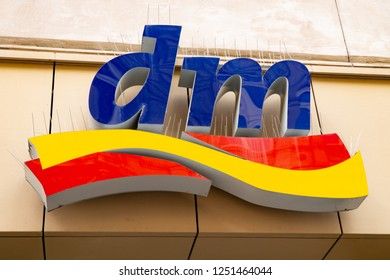 Wiesbaden, Germany - June 03 2018: DM logo on a facade.  Dm-drogerie markt is a chain of retail drugstore chain for cosmetics, healthcare and household products and food.
