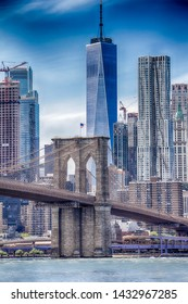 A wiew of Brooklin bridge in New york with skycraper in the background