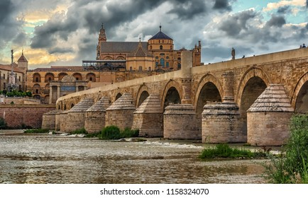 Wiew of the Roman Bridge (Puente Romano) and Umayyad Mosque (Mezquita) in the evening, Cordoba, Spain,