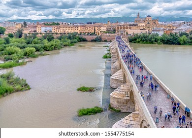 Wiew of the Roman Bridge (Puente Romano), Umayyad Mosque (Mezquita-Cathedral), Gudalquivir river and old town of Cordoba view from the top of the Calahorra tower. Cordoba, Spain,