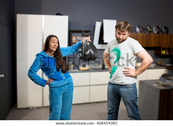 Wife asking her husband to take out the trash