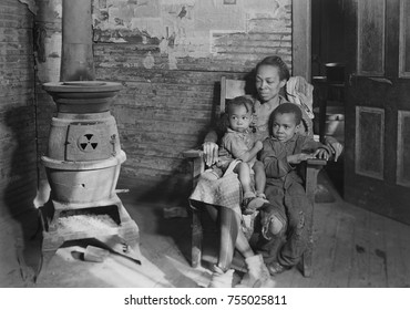 Wife and children of an unemployed African American coal miner in Scott's Run, West Virginia. Photo by Lewis Hine, March 1937.