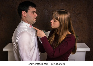 Wife finded red lipstick on shirt collar of her unfaithful husband - infidelity concept