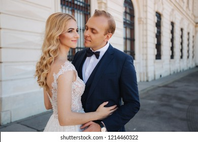 Wife with her husband walking by the palace. they spend time togeter