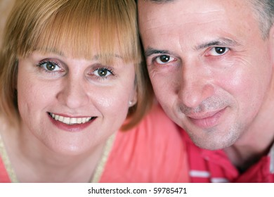 Wife and husband in middle age smiling