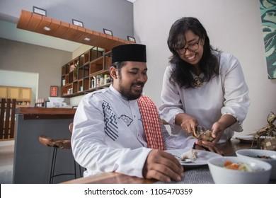 wife preparing food for husband. break fasting on muslim ramadan